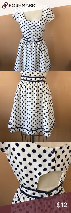 Polka dot dress Cuteness! Navy blue polka dots! Sexy little lower back cut out! Yay! You'll feel so good in this dress- I wish it were my size, le sigh.... Lucca Couture Dresses