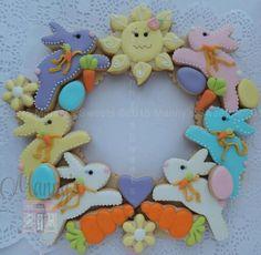 Manny's Cookies:  Easter.   Bunnies.  Carrots.  Eggs.  Flowers.  Sun.