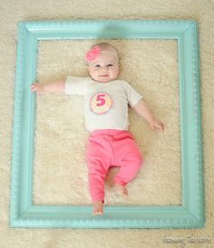 Love the idea of finding a big pretty picture frame and taking a picture inside of it each month to show how baby is growing!