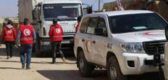 At least 16 people died after a car bomb detonated near a bus convoy of Syrian evacuees leaving towns near Aleppo.