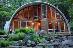 This steel quonset home in New York handles both the summer and winter months with ease. The windows let in lots of natural light - it would be the perfect spot to watch the snow fall!