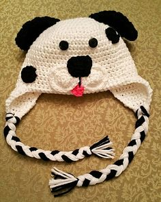 My puppy love earflap hat. Perfect for your little one. This hat can be made from newborn up to 10 years of age. This hat will be available for purchase in my store soon. Some of the pattern credit goes to Repeat Crafter Me.  #crochet #crocheter #crochetersofinstagram #spots #polkadotpup #polkadotpuppy #puppybeanie #kids #children #dottiedog #craft #handmade #handmadecrafts #handcrochet #craftymama #craftymom #earflaphat #beaniewithbraids #dazzledknits by dazzledknits