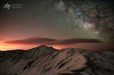 https://flic.kr/p/bA24Td | Lenticular Mountain Milky Way | A vision that finally came true...  Milky Way clouds appear above glowing lenticular clouds and rugged peaks in this colorful night-time mountain scene.  This image is the result of a lot of planning to get things just right - factoring in snowpack, moonlight, light pollution, astronomical timing, camera gear, backpacking gear, special use permits, friends who'd even consider joining me for something like this, and (mother nature's…