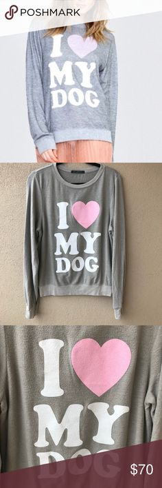 "NWT Wildfox Must Love Dogs Sweatshirt Brand new with store tags Must Love Dogs sweatshirt from Wilfox.  This supersoft fleece sweater has a faded graphic accent that says I Heart My Dog (I Love My Dog).  Crew neckline, long raglan sleeves, and purposeful pilling for a worn in, comfortable look. Brand new condition.  - Size Small S  - Approx. 20.5"" armpit to armpit - Approx. 25"" long - 47% polyester, 47% rayon, 6% spandex - Closet ID # 0820, 0821 Wildfox Tops Sweatshirts & Hoodies"