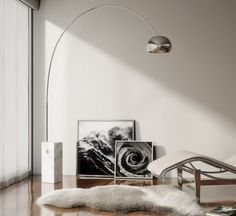 FLOS Arco floor lamp complements the modern feel in this living room interior  - complete with natural, gray and white accents and hardwood flooring.