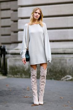 Thigh-high boots styled with a dress. We're in love with this look.
