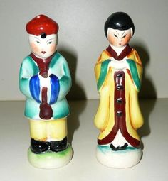 Cute set of vintage set of  5 tall salt and pepper  shakers representing a  Chinese couple with colorful costumes. They are both marked on the bottom