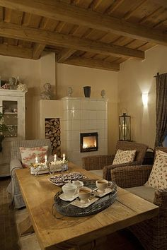Love the simplicity of this tiled masonry stove French Cottage, Cozy Cottage, Condo Living, My Living Room, Provence, Cosy Kitchen, Rustic Room, Timber House, Wood Interiors