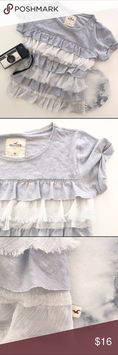 Hollister Ruffle Tiered Layers Gray Soft T-Shirt Fun ruffled soft top by Hollister, with layers of texture and ruffles! Gray and white. So versatile, dress it up or wear it casually. Grey And White, Gray, Hollister Tops, Fashion Design, Fashion Tips, Fashion Trends, Underarm, Lace Shorts, Ruffles
