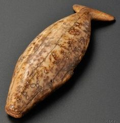 Eskimo [Inuit? Native American Indian?] carved walrus ivory toggle, 19th century, in the form of a whale, with incised detail. [Prices4Antiques.com]