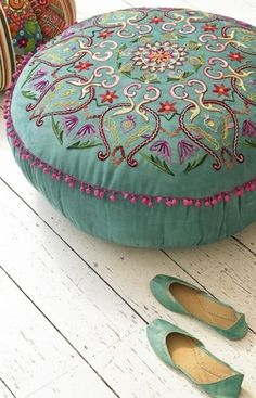 The color of this 'suzani' style pouffe is so dreamy… works great for a shabby-chic house with an ethnic, bohemian edge. The pink pom-pom trimming is feminine, yet not overboard; it's still an adult's pouffe. Boho Chic, Bohemian Decor, Shabby Chic, Gypsy Decor, Turquoise, Teal, Aqua, Moroccan Pouf, Moroccan Tiles