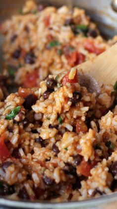 Mexican Tomato Rice and Beans - I would substitute pinto beans for the black beans and use green chilis instead of a jalapenos.