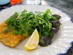 Get this all-star, easy-to-follow Chicken Cutlets with Spicy Arugula recipe from Valerie Bertinelli