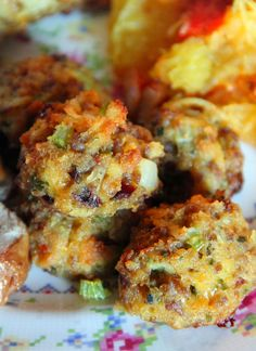 Sausage & Stuffing Balls: 1 lb sausage meat 1 stalk celery, finely diced 1/2 medium onion, finely diced 1/4 cup dried cranberries, finely chopped 1/2 cup aged cheddar cheese, shredded 1 box Stove Top Stuffing mix 1 cup chicken broth 2 eggs