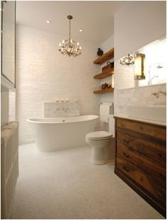 Master bath: white painted brick wall. natural wood with white base.