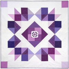 """Orchid Mega quilt pattern was designed by Ramona Rose for Robert Kaufman Fabrics. Uses Kona Cotton solids in a variety of purples form the Kona Cotton Fields of Iris fat quarter bundle.  Finished size: 95"""" x 95"""""""