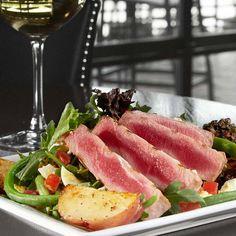 Ahi Tuna Nicoise Salad - seared ahi tuna, mixed greens, arugula, hard boiled egg, roasted red potatoes, green beans, tomato, basil, tapenade, apple cider vinaigrette at @BarLouie