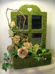 Moss Wall Planter with silk roses and kiwi branches