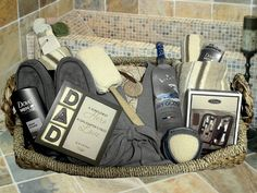 This gift basket consist of a large flat woven design wicker tray basket which includes the following items: *Two premium beige/grey/ivory blue stripe bath towels *A pair of grey color comfy men bath slippers * Grey waffle design spa bath robe *Travel Grooming Set (File/Scissors/Tweezers/Collapsible comb/Toenail clipper/Nail clipper/Multi-function knife/Battery-operated nose hair groomer with vintage leatherette zipper case) *Dove Men Odor Guard Body wash & deodorant *750ml bottle of Grey…