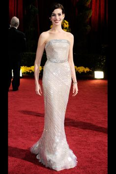 What: Armani Prive Where: Academy Awards in 2009 Why: The exquistely arranged pailettes flattered Hathaway's figure perfectly and showed a new grown-up side to the actress.   - HarpersBAZAAR.com