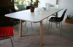 I love Michael Marriott's Barbican Table: http://www.michaelmarriott.com/furniture/barbican/