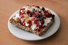 healthy snack - Slice of toasted whole grain bread with cottage cheese, sunflower honey, berries, raisins and shredded coconut