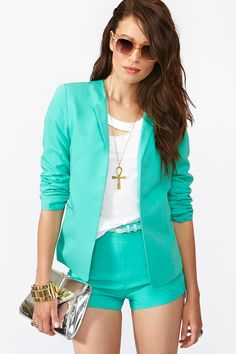Lagoon Blazer Nasty Gal  Brighten up your day with a neon green suit, adding a bit of fun to your work outfit.