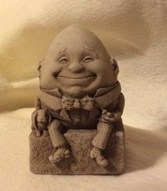 "George Carruth limestone sculpture ""Humpty Dumpty"" from our collection. Lewis Carroll, Alice In Wonderland Doll, Dremel Wood Carving, Humpty Dumpty, Egg Art, Antique Decor, Creepy Cute, Nursery Rhymes, Cool Artwork"