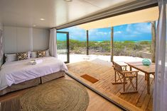 Cosmoledo may be over km from the capital, but don't let the remote location deter you. Guest can expect an understated luxury from this Eco Camp. Luxury Accommodation, Architectural Digest, Seychelles, Safari, Remote, Camping, Windows, Blue, Furniture