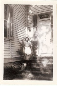 "1950's Galveston Texas, from the estate of Lenora Dorian -- ""The Help"" -- her name is not recorded. Odd proportions in the photo of the woman made small by the imposing house."