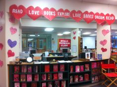 Like this idea for the front of my circulation desk.  Like the construction paper hearts written by students about their favorite books.