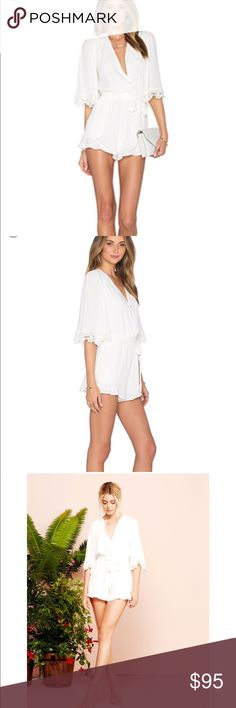 💗 Lovers & Friends Reese Romper 💗 SOLD OUT EVERYWHERE ⭐️ Lovers & Friends 'Reese' Romper ⭐️ Size S ⭐️ White w/ White Lace Sleeve Accents & Flutter Detail on the Shorts ⭐️ Worn Once ⭐️ Pet-Free & Smoke-Free Home ⭐️ Fast Shipper ⭐️ Top-Rated Seller Lovers + Friends Dresses