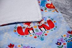 A personal favorite from my Etsy shop https://www.etsy.com/listing/509440743/set-of-4-fox-and-owl-baby-burp-cloth