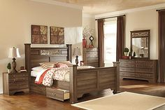 """The Allymore Poster Bed w/ Storage from Ashley Furniture HomeStore (AFHS.com). The Vintage Casual look of the """"Allymore"""" bedroom collection features an aged brown rough sawn finish flowing over the replicated oak grain along with the panel detailing and the warm bronze color finished decorative vine inserts to create a collection that is sure to transform any bedroom décor into a relaxing cottage retreat."""