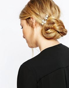 Lauren Conrad's Messy Bun via Brit + Co To achieve this look, spray your hair with a dry texturizing spray like Not Your Mother's Double Take Dry Finish Texture Spray ($6) — this will give it some grit and will help make it appear intentionally messy. Part your hair in the middle and gather it into a low bun at the nape of your neck, leaving a thick piece of hair out of the bun. Secure the bun with an elastic, and then wrap the thick piece of hair around the elastic so it's all covered up.