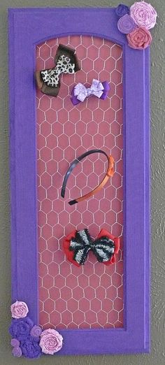 So super easy... if you can find the right supplies. Upcycled cabinet door frame with chicken wire and little paint. Perfect for hairbows!