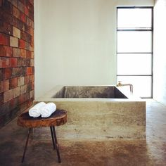 Concrete bathtub at Drift San Jose