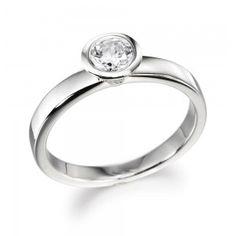 prettyyyyyyyyyyyyyy. full bezel engagement ring is where it's at for me!