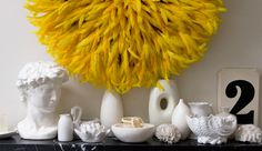 I adore this yellow feather wreath(I assume it is a wreath) with all the white accessories.