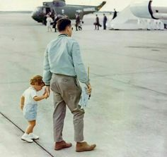 Agent Tom Wells with John Jr waiting for President Kennedy's plane