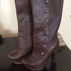 Chocolate Brown Leather UGGS Brand new, never worn UGG boots! Sheepskin padding under the foot pad. They are beautiful, just a little too tall for me! UGG Shoes