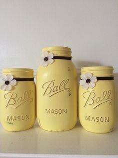 Items similar to Set of 3 painted mason jars 1 quart and 2 pint size. Painted in a beautiful yellow. Embellished with brown ribbon and burlap button flowers. on Etsy Ball Mason Jars, Mason Jar Gifts, Mason Jar Diy, Diy Jars, Wine Bottle Crafts, Jar Crafts, Bottles And Jars, Glass Jars, Mason Jar Projects