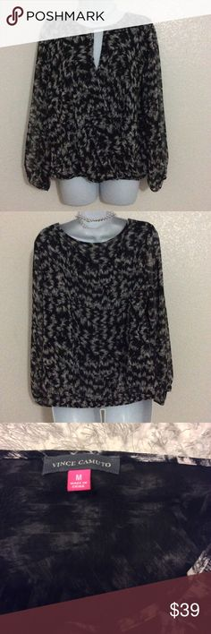 Vince Camuto Faux Wrap Shirt Beautiful shirt in black and white.  Size Medium.  Polyester material with elastic at wrists and waist. Body is line, sleeves are not. Great used condition. Vince Camuto Tops