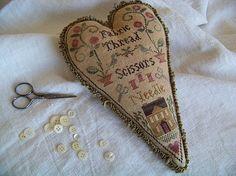 Beautiful sampler style Pin Keep
