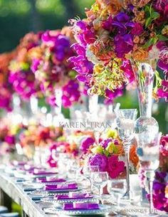 For Summer weddings - centerpieces in bold, bright colors can be elegant ~ Karen Tran Florals