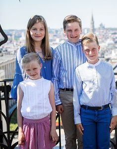 Princess Eleonore (front L), Crown Princess Elisabeth (back L), Prince Emmanuel (front C), and Prince Gabriel (R) pose during a photo-shoot of the Belgian Royal Family's vacation at the MIM, Musical Instruments Museum, in Brussels, on July 19, 2016