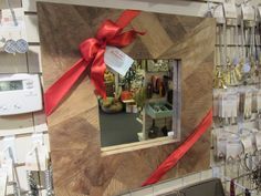 In Little Rock, red ribbon and a tag suggest that this mirror would make a great grab and go gift.