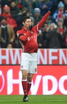 Bayern Munich's Polish striker Robert Lewandowski celebrates scoring the opening goal during the UEFA Champions League group D football match between FC Bayern Munich and Atletico Madrid in Munich, southern Germany, on December 6, 2016.  / AFP / CHRISTOF STACHE