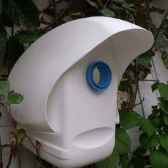 Plastic bottle birdhouse made from laundry detergent bottles