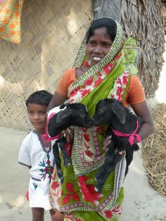 Hadi Amin, a Trickle Up participant from India, with her son and goats.
